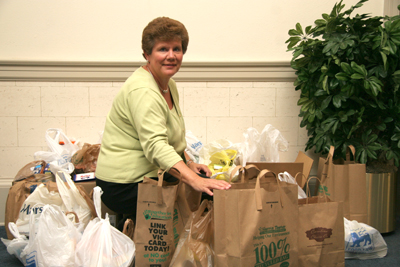 Luann Clark collects items for food drive.