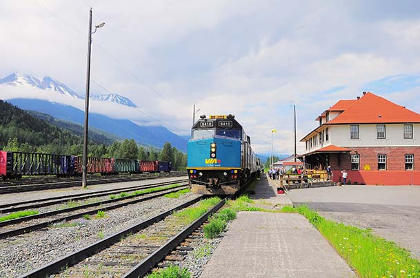Canadian mountains and train station