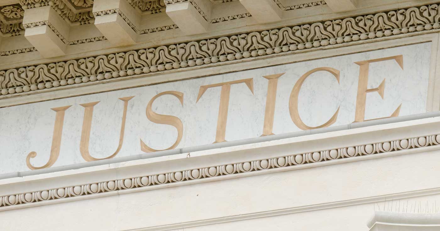 The word justice engraved on courthouse