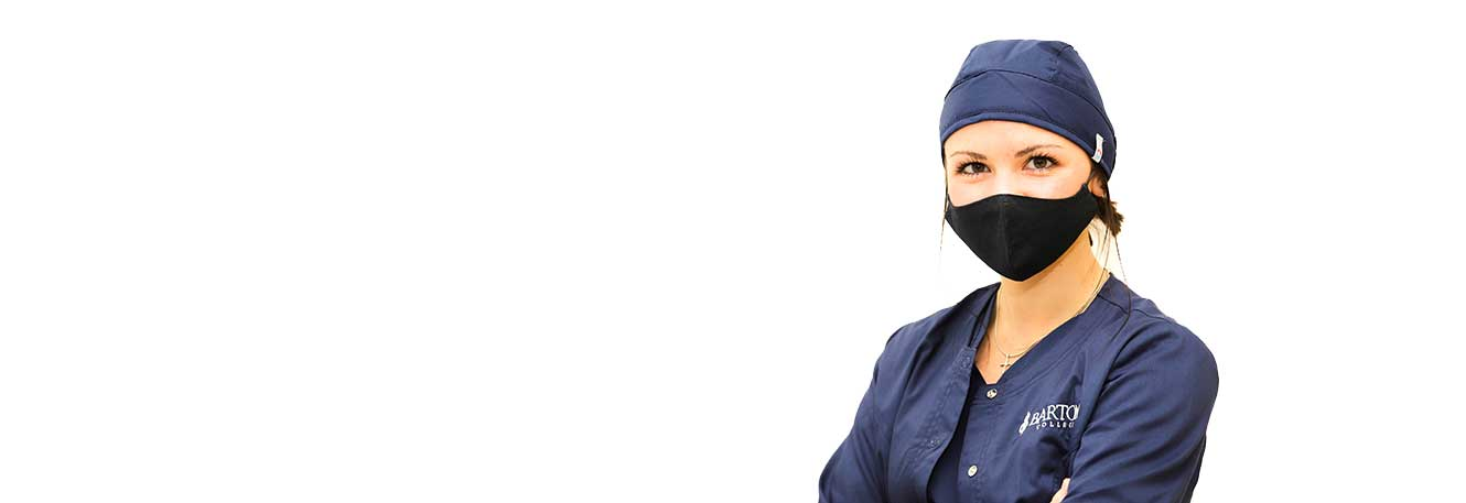 Masked nursing student on white background